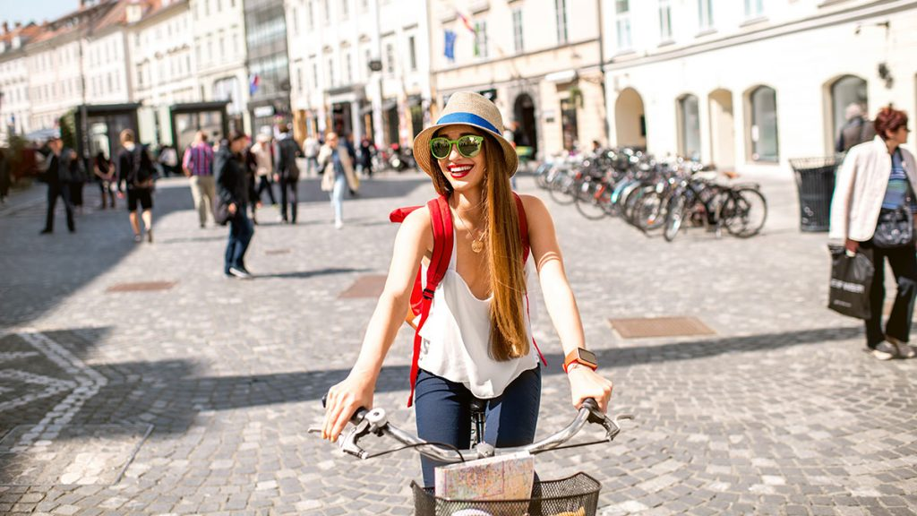 girl riding bicycle: Top 8 reasons to study abroad