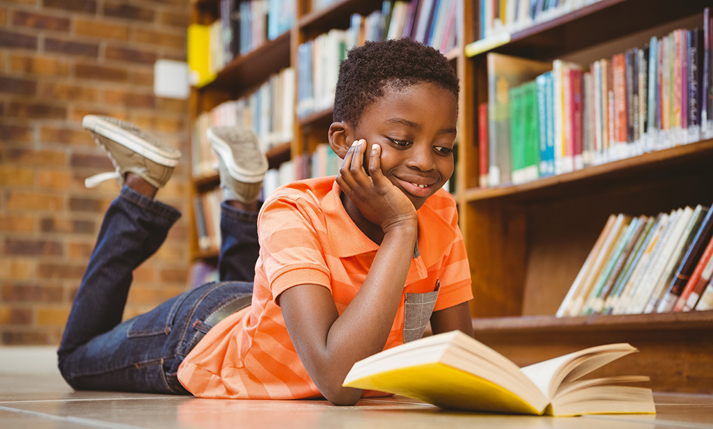 Boy Reading a Book: Conscious reading;  Reading Strategies to improve vocabulary